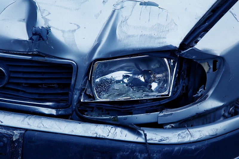 Close Up of a Car Accident  with a Damaged Headlight