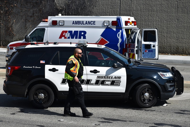 Police and an Ambulance on the Scene of a Car Accident