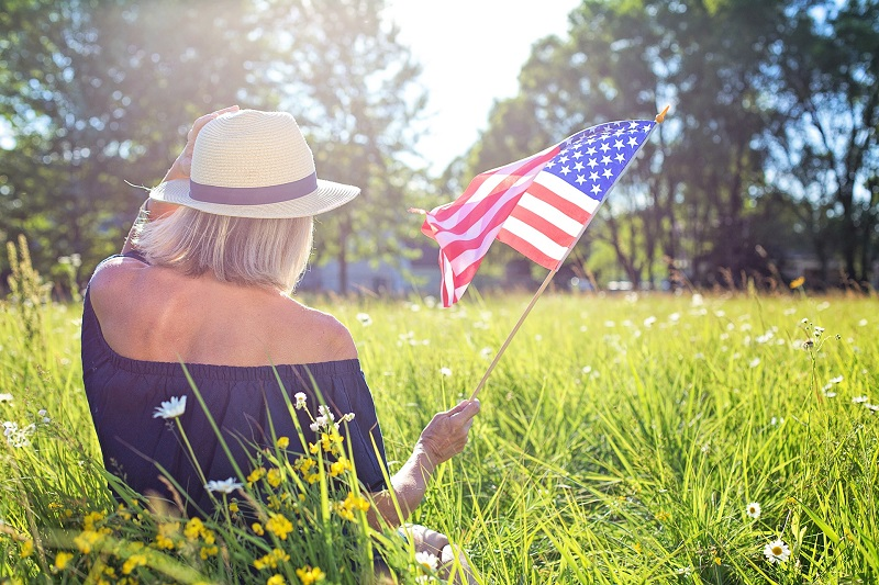 July 2020 Things to Do in Orange County Woman Holding Flag in a