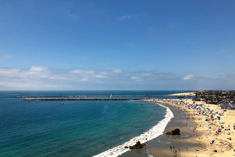 Where to Take Your Drivers Ed Test in Newport Beach Beach with People Enjoying the Weather