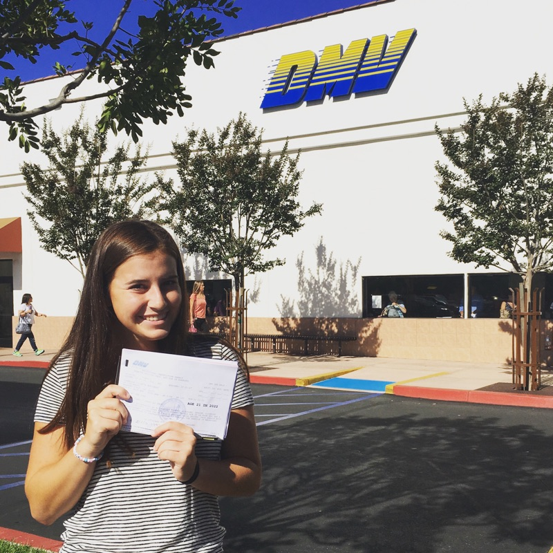 Behind the Wheel Test in Irvine Teen Girl Standing Outside of a DMV