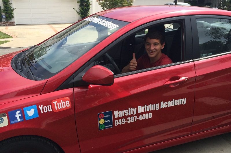 San Clemente Behind the Wheel Test Tips and Tricks Student in a Car Giving a Thumbs Up