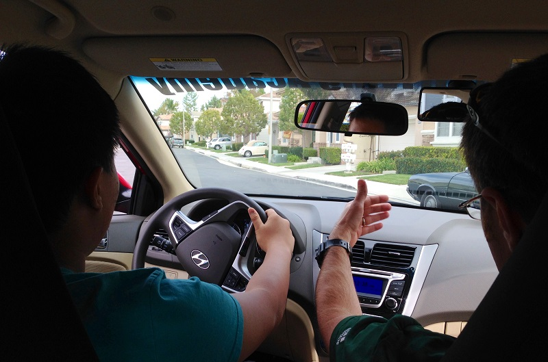 Where to Take Driving Lessons in Laguna Beach and Laguna Niguel Student in a Car with a Trainer