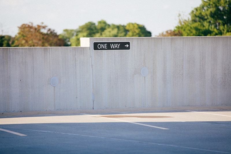 Where to Practice Driving in Costa Mesa Empty Parking Spaces with a Sign That Says One Way