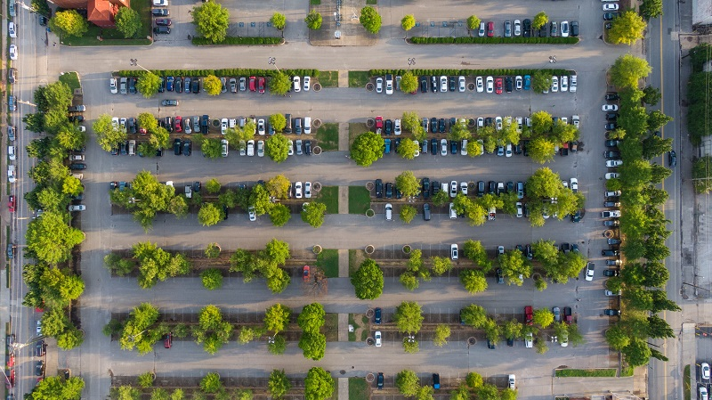 Where to Practice Driving in Newport Beach Overhead View of a Parking Lot with Lots of Trees