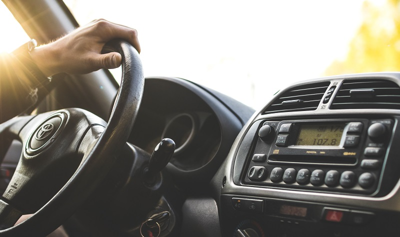 Aliso Viejo Driving School Practice Tips Person with Hand on a Steering Wheel