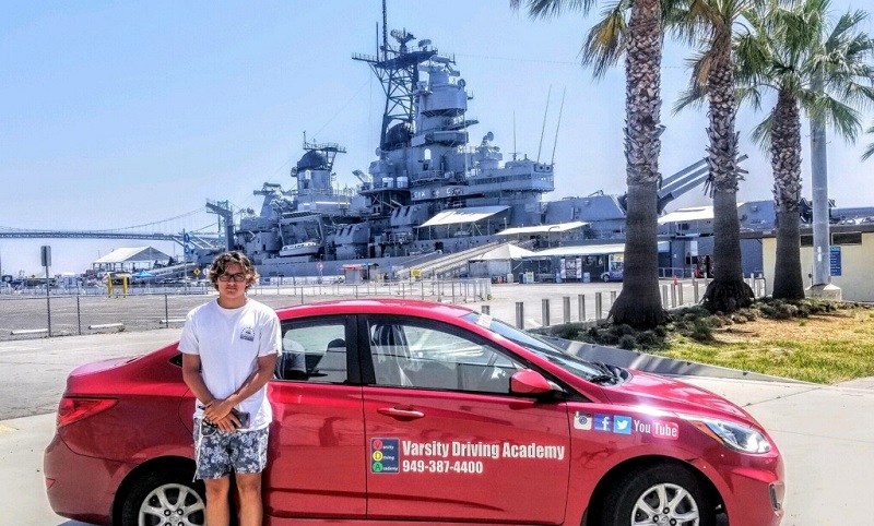 Dana Point Driving Lessons Student Standing Next to a Training Vehicle