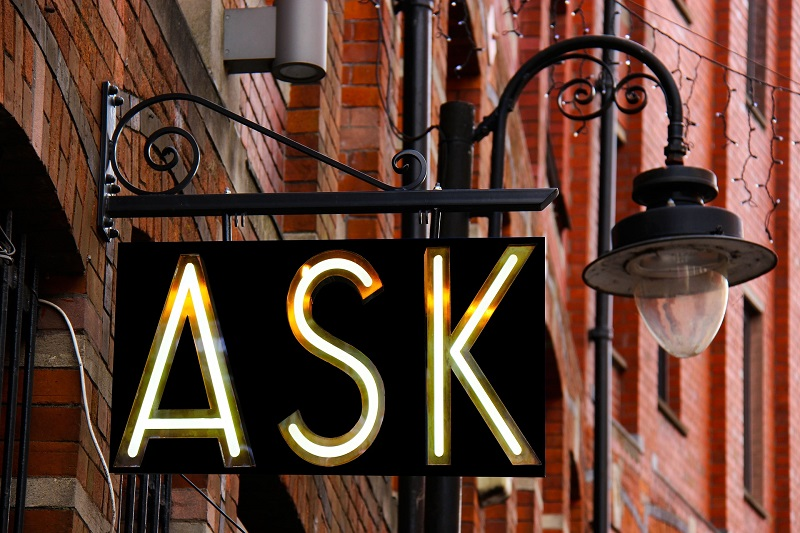Laguna Beach Driving Lessons Tips a Sign that Says Ask