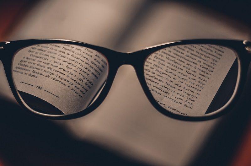 Laguna Beach Driving Lessons Tips a Pair of Glasses Focusing on a Book