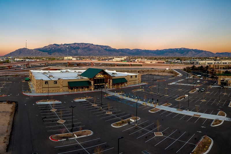 Where to Practice Driving in Orange California Overhead View of an Empty Parking Lot with a Single Building at One End